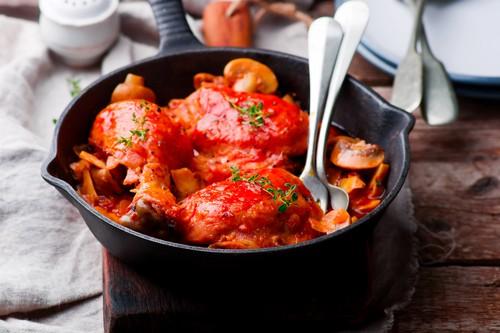 Marengo chicken in a frying pan. . selective focus