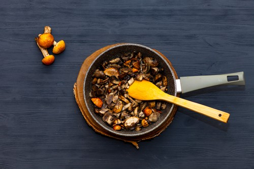 Cooking mushrooms in a pan. Fried mushrooms, boletus, orange-cap boletus.