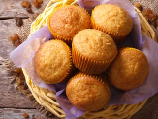 Orange muffins and raisins close-up. horizontal top view